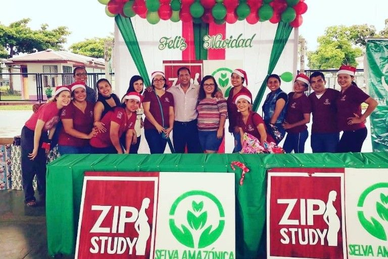 Lucy Brown in a group photo for a Zip Study event where most everyone wears Santa Claus hats.