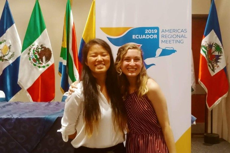Lucy Brown poses for a photo with her mentor at the 2019 Americas Regional Meeting in Equador.