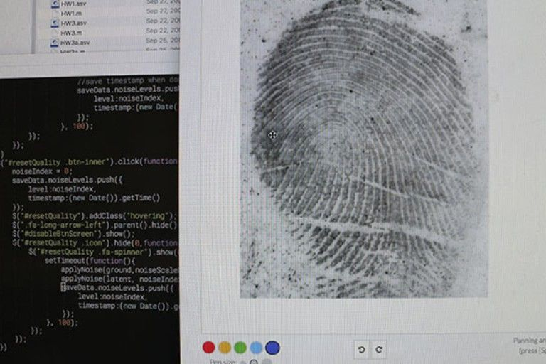 Computer code next to image of a large fingerprint